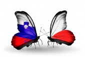 Butterflies with  Slovenia and Poland flags — Foto Stock