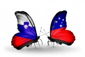 Butterflies with Slovenia and Samoa flags — Foto Stock