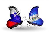 Butterflies with Slovenia and Salvador flags — Foto de Stock
