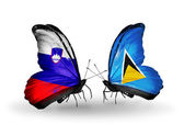 Butterflies with Slovenia and Saint Lucia flags — Stock fotografie