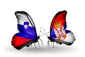 Butterflies with Slovenia and Serbia flags — Foto Stock