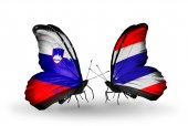 Butterflies with  Slovenia and Thailand flags — Foto Stock