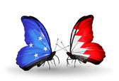 Butterflies with Micronesia and Bahrain flags — Stock fotografie