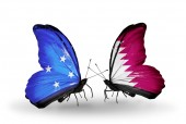 Butterflies with Micronesia and Qatar flags — Stock fotografie