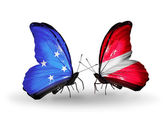 Butterflies with Micronesia and Latvia flags — Stock fotografie