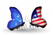 Butterflies with Micronesia and Liberia flags — Foto Stock