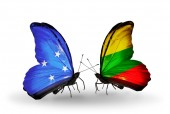Butterflies with  Micronesia and Lithuania flags — Stock fotografie