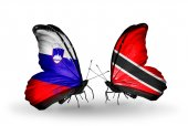 Butterflies with Slovenia and Trinidad and Tobago flags — Stock fotografie