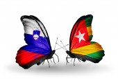 Butterflies with Slovenia and Togo flags — Stock fotografie