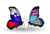 Butterflies with Slovenia and  Fiji flags — Stock fotografie