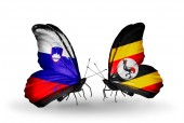 Butterflies with Slovenia and Uganda flags — Foto Stock