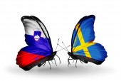 Butterflies with Slovenia and Sweden flags — Stock fotografie