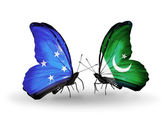 Butterflies with Micronesia and Pakistan flags — Stock fotografie