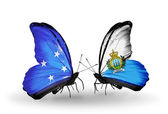 Butterflies with Micronesia and San Marino flags — Stock fotografie