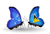 Butterflies with Micronesia and Saint Lucia flags — Foto Stock