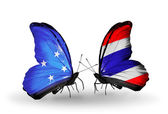 Butterflies with Micronesia and Thailand flags — Stock fotografie