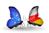 Butterflies with Micronesia and South Ossetia flags — Stock fotografie