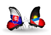 Butterflies with Slovakia and Antigua and Barbuda flags — Foto Stock