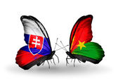 Butterflies with Slovakia and  Burkina Faso flags — Stock fotografie