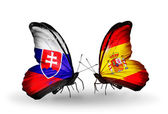 Butterflies with Slovakia and Spain flags — Stock fotografie