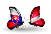 Butterflies with Slovakia and Latvia flags — Stock fotografie