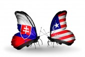 Butterflies with Slovakia and Liberia flags — Stock fotografie