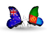 Butterflies with New Zealand and Eritrea flags — Stock Photo