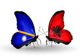 Butterflies with Nauru and Albania flags — Stock Photo