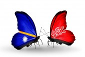 Butterflies with  Nauru and Waziristan flags — Stock Photo