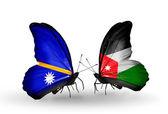 Butterflies with Nauru and  Jordan flags — Stock Photo