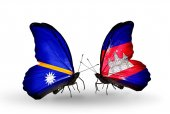 Butterflies with Nauru and Cambodia flags — Stock Photo