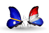 Butterflies with Nauru and Luxembourg flags — Stock Photo