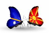 Butterflies with Nauru and Macedonia flags — Stock Photo