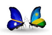 Butterflies with Nauru and Rwanda flags — Stock Photo