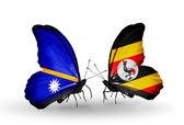 Butterflies with Nauru and Uganda flags — Stock fotografie