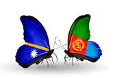 Butterflies with Nauru and Eritrea flags — Stock Photo