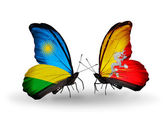 Butterflies with Rwanda and Bhutan flags — Fotografia Stock