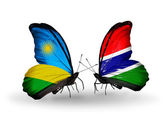 Butterflies with  Rwanda and Gambia flags — Stockfoto