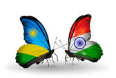 Butterflies with Rwanda and  India flags — Stok fotoğraf