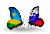 Butterflies with Rwanda and Slovenia flags — Stock Photo