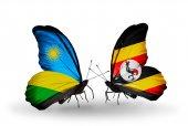 Butterflies with Rwanda and Uganda flags — ストック写真