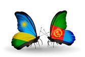 Butterflies with Rwanda and Eritrea flags — Stock Photo