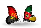 Butterflies with Angola and Mozambique flags — Stock Photo