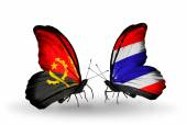 Butterflies with Angola and Thailand flags — Stock Photo