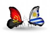 Butterflies with Angola and Uruguay flags — 图库照片