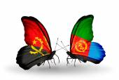 Butterflies with Angola and Eritrea flags — Stock Photo