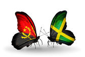 Butterflies with Angola and Jamaica flags — Stock Photo