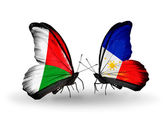 Butterflies with Madagascar and Philippines flags — Stock Photo