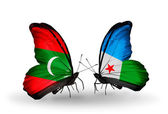 Butterflies with Maldives and Djibouti flags — Stock Photo