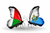 Butterflies with Madagascar and San Marino flags — Foto de Stock